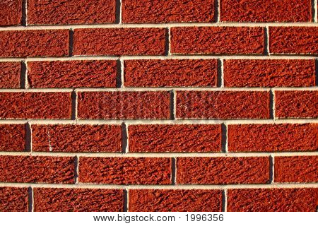 Stright on image of a brick wall poster