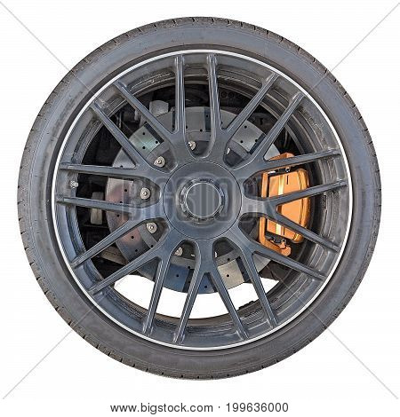 wheel rim with tire of sports car isolated on white background