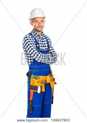Young Confident Construction Worker In Uniform And Tool Belt With Crossed Arms