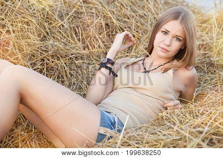 Beauty Woman In The Straw In Field
