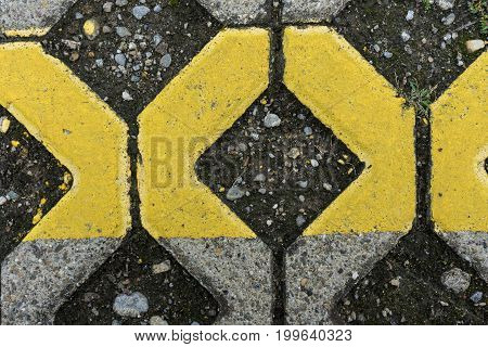 yellow marks on paving stone abstract structure