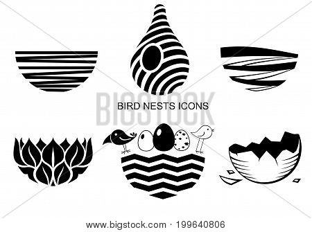 Set icons Bird's Nest for a logo or emblem in the technique of sketching. Vector graphics. Two funny birds and eggs.