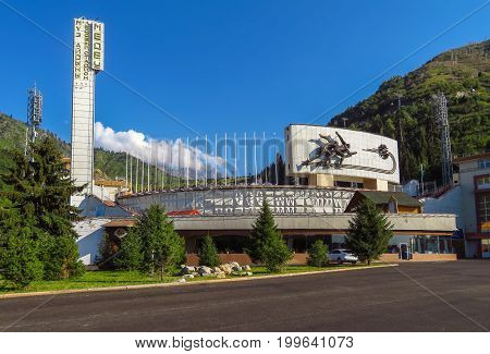Almaty Kazakhstan - July 21 2017: Famous skating rink Medeo and mountains at the background in Almaty Kazakhstan