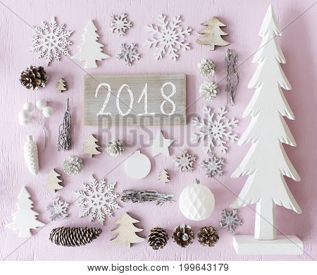 Sign With Text 2018 For Happy New Year Greetings. Flat Lay Of Christmas Decoration Like Tree, Ball, Star And Fir Cone. Rose Quarty Wooden Background