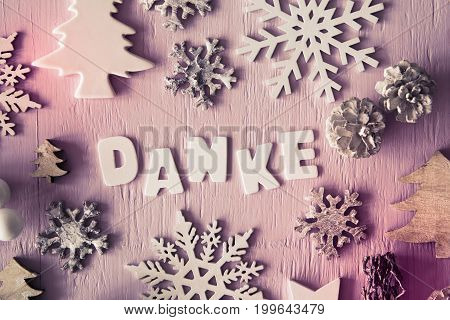 Letters Building German Danke Means Thank You. Many Christmas Decoration Like Tree, Star, Fir Cone And Snowflake. Flat Lay With Rose Wooden Background And Vintage Style, Instagram Filter