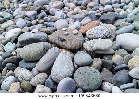 the sun of pebbles on the beach in summer vacation posted man