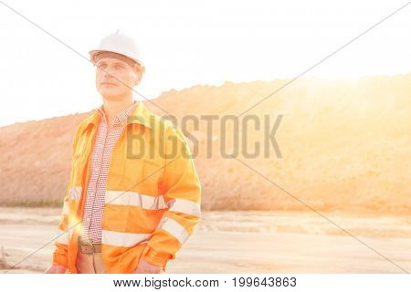 Thoughtful male supervisor looking away at construction site