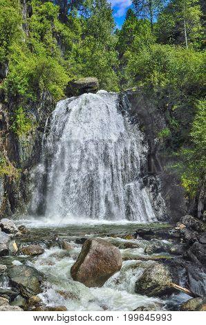 Waterfall Corbu in rocks of lakeTeletskoe Altai Mountains Altay Republic Siberia Russia