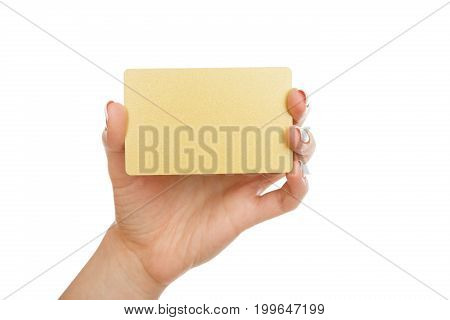Woman's hand holding blank plastic credit card isolated on white background, close-up, cutout, side view