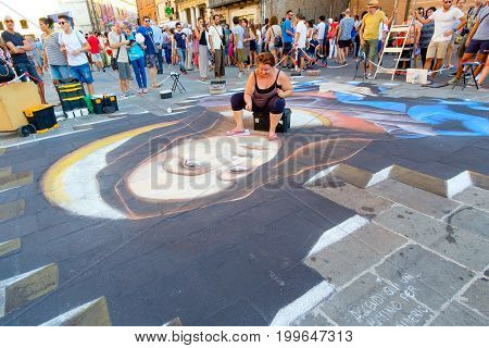 FERRARA Italy - August 27 2016: Buskers Festival 2016 in Ferrara Emilia Romagna Italy. Busker Festival is a popular event with street artists which is held annually in the historic center of Ferrara