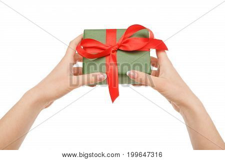 Female hand give present in paper with red ribbon, isolated on white background, close-up, cutout