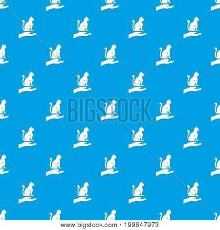 Hand holding a cat pattern repeat seamless in blue color for any design. Vector geometric illustration
