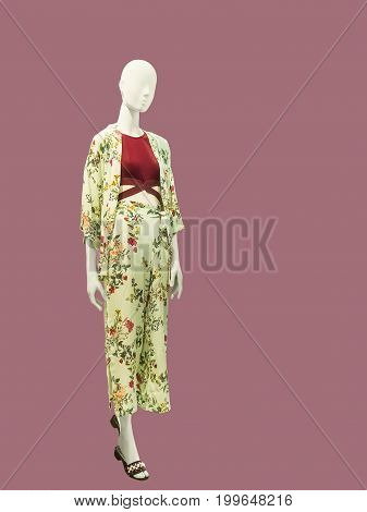 Full-length female mannequin dressed in summer fashionable clothes isolated. No brand names or copyright objects.