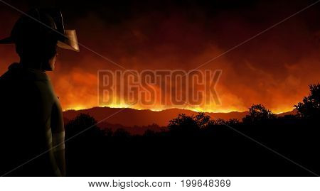 3D render of a firefighter watching helplessly as a wild forest fire burns out of control in the night