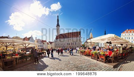 TALLINN, ESTONIA - MAY 24: View to Tallinn Town Hall on August 14, 2017 in Tallinn. Town hall with lots of tourists in the middle of summer