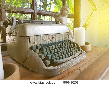 Vintage typewriter on a wood table process in vintage style