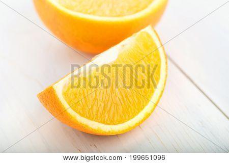 slice of ripe juicy orange on a white background
