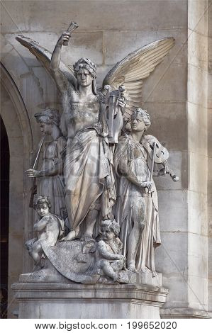 ParisFrance- April 30 2017: Opera Garnier. A composition that symbolizes the pillars of theatrical art. This is