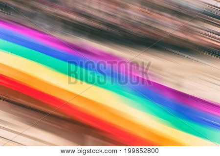 Motion Blurred Picture Of Gay Rainbow Flags During Pride Parade. Concept Of Lgbt Rights.