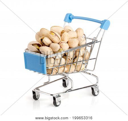 Pistachio in a shopping cart isolated on white background.