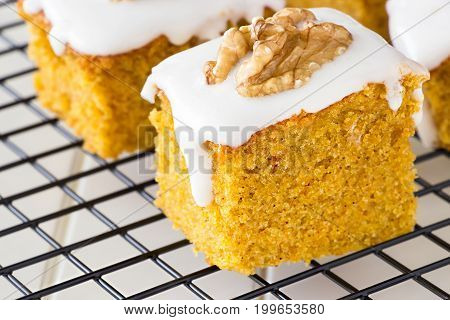 Piece Of Homemade Carrot Cake With Nut And Icing Cream. Selective Focus. Close Up.