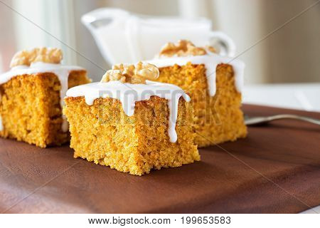 Piece Of Homemade Carrot Cake With Nuts And Icing Cream. Selective Focus. Close Up.