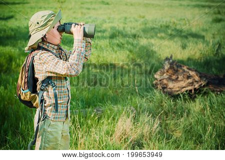 Boy exploring nature and the world around us. Adventure trips. The young scout.