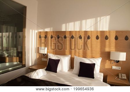 Contemporary hotel room with view and glass wall to bathroom, with empty space