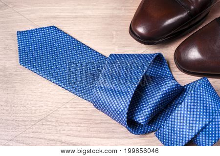 Men's accessories men's shoes tie on a wooden background. Classic men's accessories. Top view. Copy space for text.