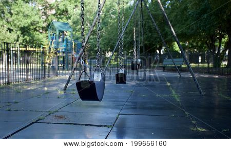 Why is the playground empty? Signifies how children don't play in the traditional way anymore.