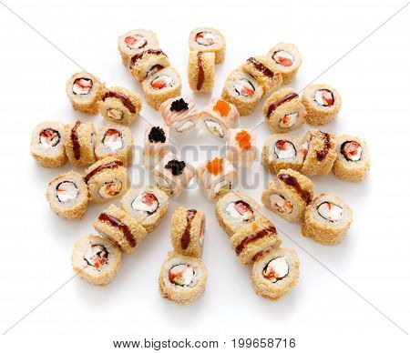 Sushi assortment isolated on white background. Big set of seafood rolls with soft philadelphia cheese covered with dry eel flakes, unagi sauce and tobiko caviar. Japanese food delivery