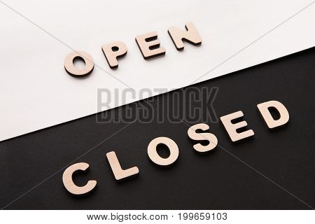 Words Open and Closed on contrast background. Opposite meaning on black and white backdrop