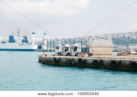 Three cargo trucks in the port on the Asian side of Istanbul, Turkey.