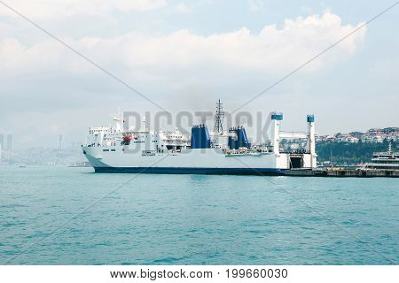 Daytime panoramic view at docked cargo ship.