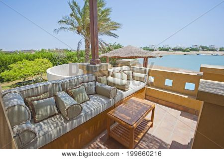 Terrace Balcony With Chairs In Tropical Luxury Apartment