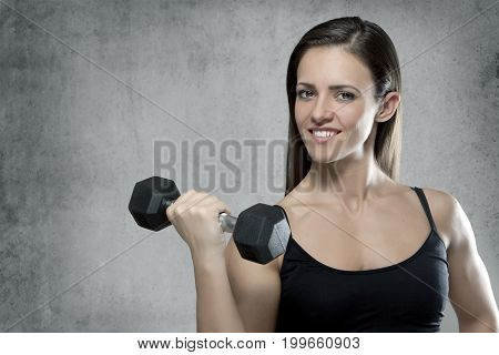 Sporty Muscular Woman With Dumbbell