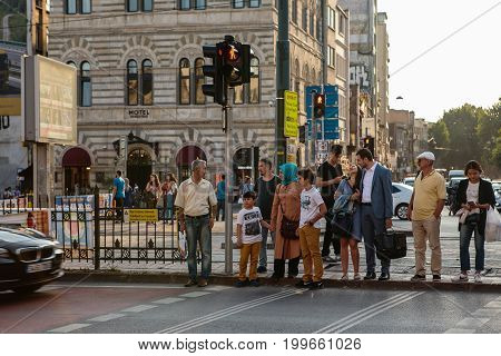 Istanbul, June 15, 2017: Many people are standing at a traffic light and waiting for a green traffic light signal to cross the road. Lifestyle. Turkey.