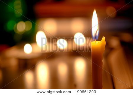 Candles Light With Blurred Book Background In The Church