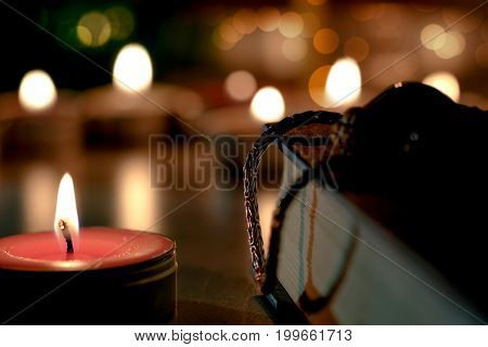 Prayer And Hope Concept On Retro Holy Bible Lit By Candle Light In A Vintage Style