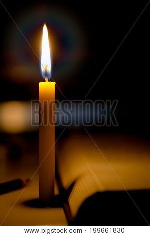 Education Concept. Candles Light With Blurred Book Background In The Church
