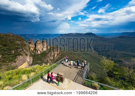 Katoomba Australia - October 20 2015: Tourists taking pictures at Blue Mountain National Park Three Sisters lookout view point in Katoomba Town Sydney New South Wales Australia.