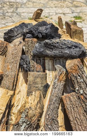 beauty stacked dry wood and coal for the hearth.close