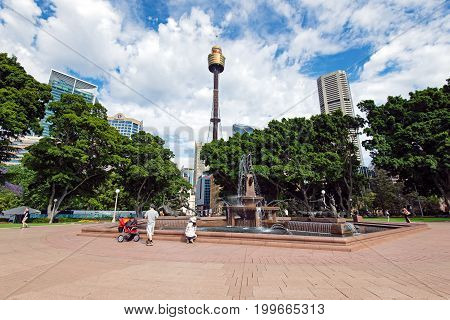 Sydney Australia - October 21 2015: Sydney skyline and water fountain in Hyde park. Hyde Park is the oldest public parkland in Australia.