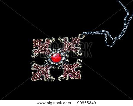 Vintage pendant isolated on black background