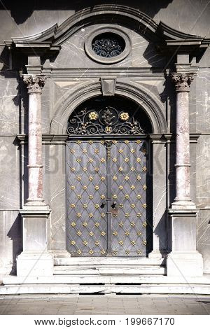 MAINZ, GERMANY - MARCH 24: The entrance door of the museum in the electoral palace of Mainz with its gold ornaments and coat of arms on March 24, 2017 in Mainz.