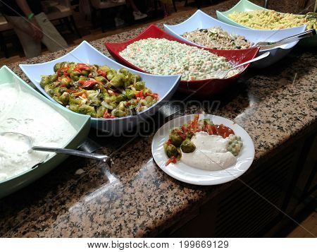 Finished dishes, buffet, all-inclusive (AI) hotel restaurant in Turkey, national and European cuisine, abundance of products