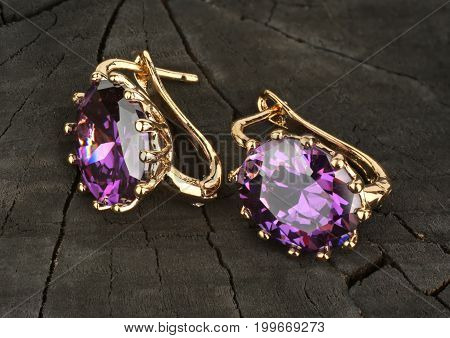 jewelry Earrings with gems on wooden background