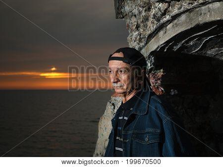Portrait Of An Elderly Lonely Pensive Man