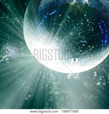 Bright patches of light on disco ball. The light at the party, the colored reflection of the mosaic glass ball disco