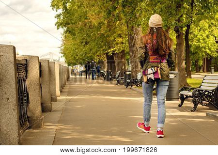 Full length portrait of happy young woman walking with dogs outdoors in autumn. Image young woman walking in river embankment